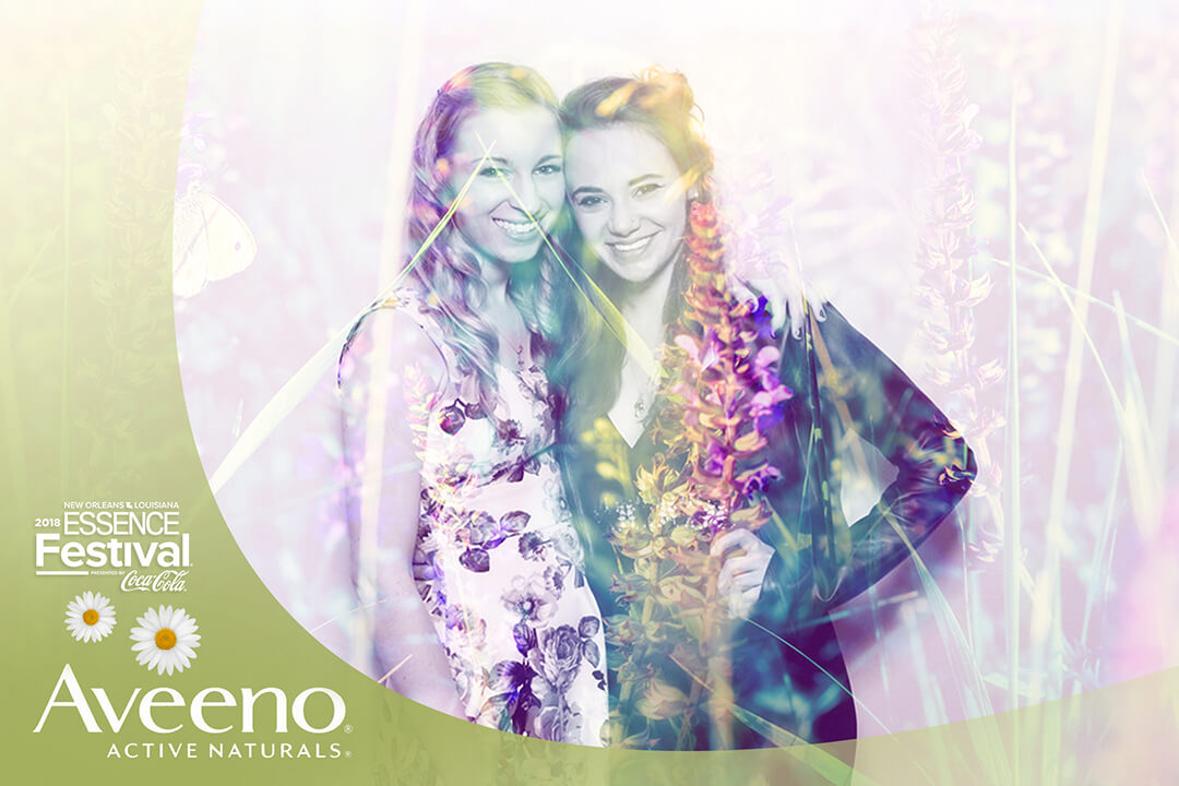 Two friends embrace in the Aveeno Photo Photo, a nature themed blending filter is applied to produce a composited image
