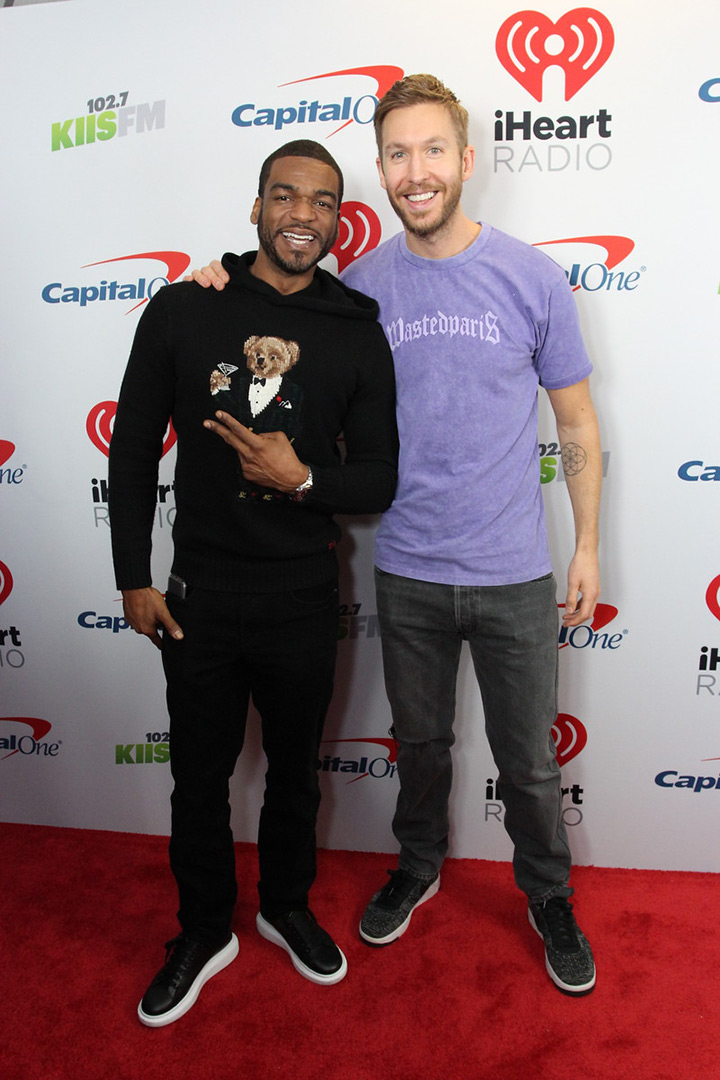 Calvin Harris poses with a fan on the red carpet at the iHeartRadio Jingle Ball Meet & Greet in New York