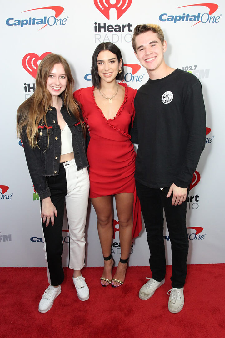 Dua Lipa poses with fans on the iHeartRadio Red Carpet