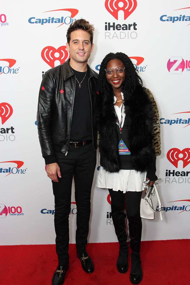 A woman poses with G Eazy at the iHeart Radio Celebrity Meet & Greet Photo Session on the Red Carpet