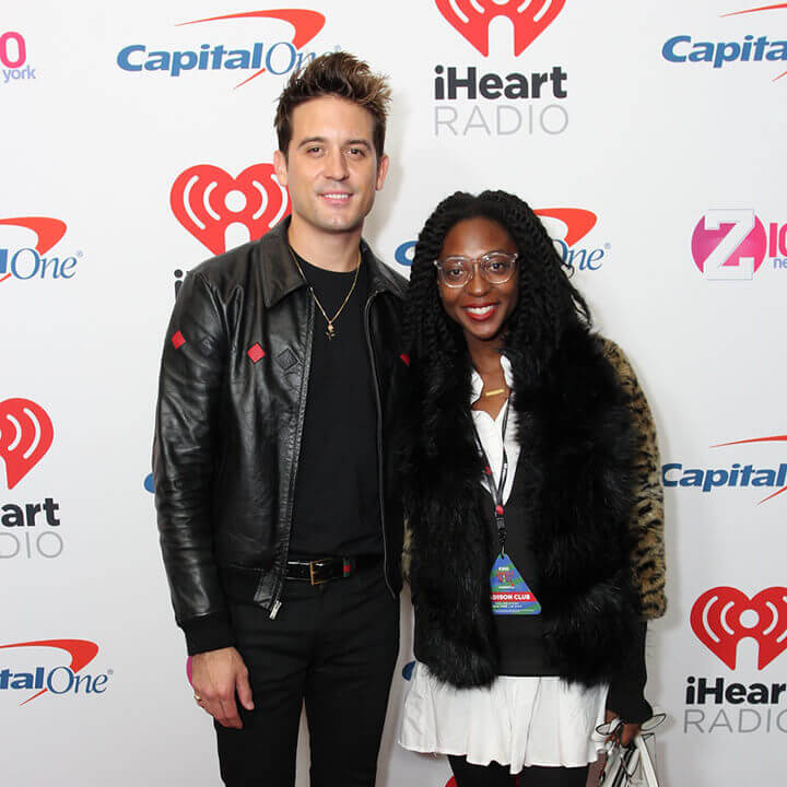 G Eazy poses with a fan on the red carpet