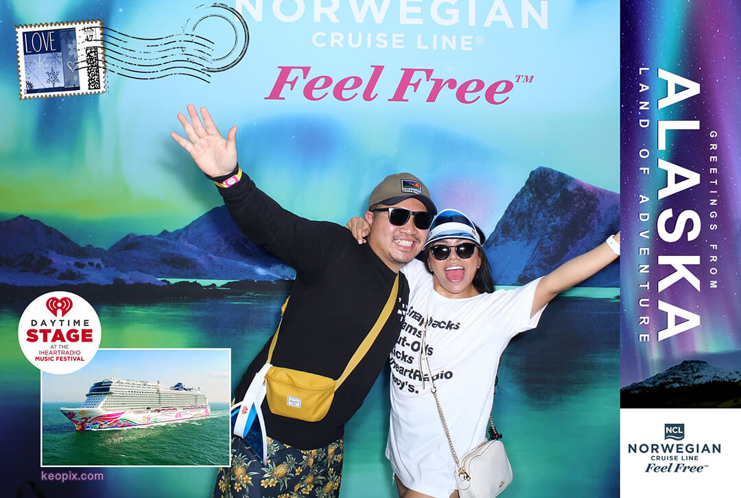 A couple poses in the Norwegian Cruise Line Photo Booth